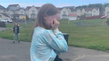 Young girl gets emotional as neighbours sing on her birthday.