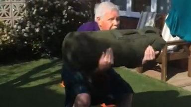 72-year-old man puts on a kilt and works out in his garden.