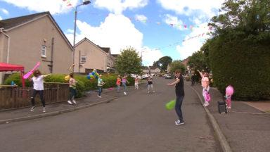 A group of neighbours complete their 100th street dance session.