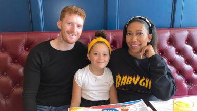 A dad meets his daughter and pregnant partner after four months apart.