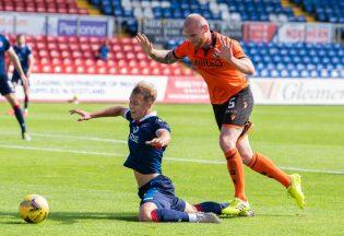 Controversy: Harry Paton goes down in the box against Dundee united