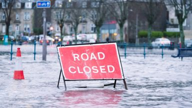 Road closed, flooding.