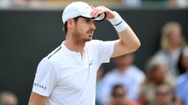 10/07/19 WIMBLEDON MIXED DOUBLES THIRD ROUND ANDY MURRAY/SERENA WILLIAMS v BRUNO SOARES/NICOLE MELICHAR WIMBLEDON - LONDON Andy Murray in action against Bruno Soares and Nicole Melichar