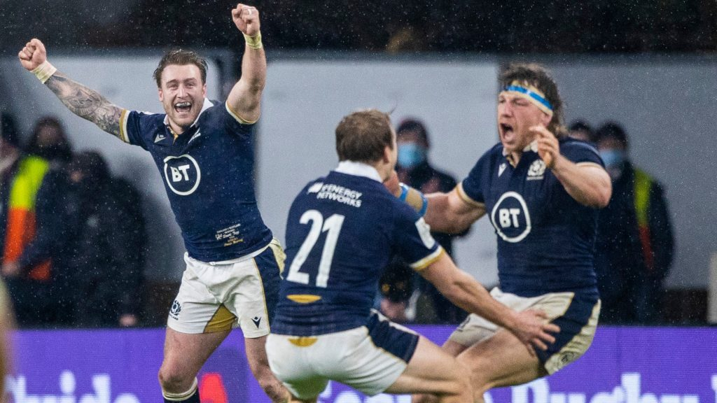 Triumph: The Scotland players celebrate on the Twickenham field.