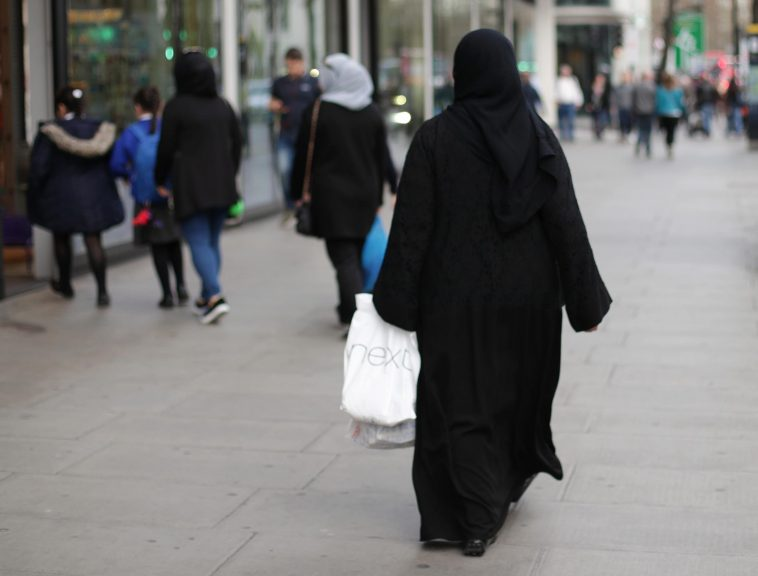 New figures show that racist hate crimes have fallen, while attacks on transgender Scots rise.