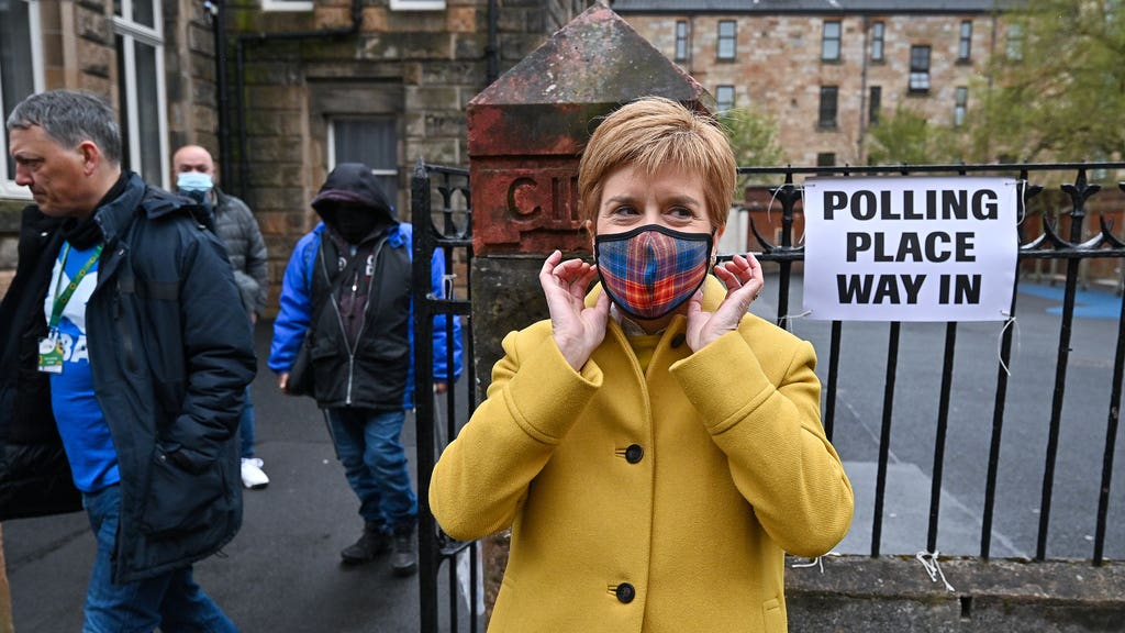 First Minister and leader of the SNP Nicola Sturgeon arrives to cast her vote.