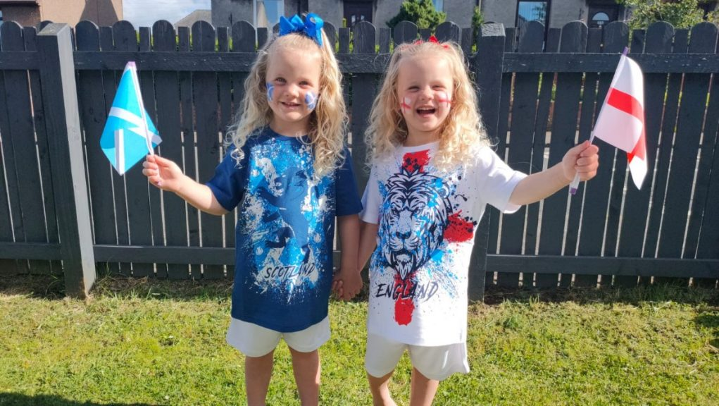 Twin rivalry: Aurora and Briar-Rose will cheer against each other during Scotland's Euro clash with England.