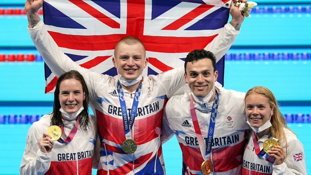 Great Britain's Kathleen Dawson, Adam Peaty, James Guy and Anna Hopkin with their gold medals for the Mixed 4 x 100m Medley Relay at the Tokyo Aquatics Centre on the eighth day of the Tokyo 2020 Olympic Games in Japan. Picture date: Saturday July 31, 2021.