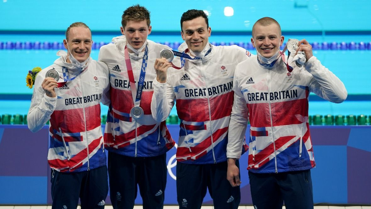Great Britain's (left-right) Luke Greenbank, Duncan Scott, James Guy and Adam Peaty after winning the silver medal in the Men's 4 x 100m Medley Relay at the Tokyo Aquatics Centre on the ninth day of the Tokyo 2020 Olympic Games in Japan. Picture date: Sunday August 1, 2021.