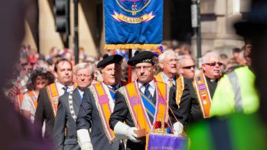 Orange walk parade