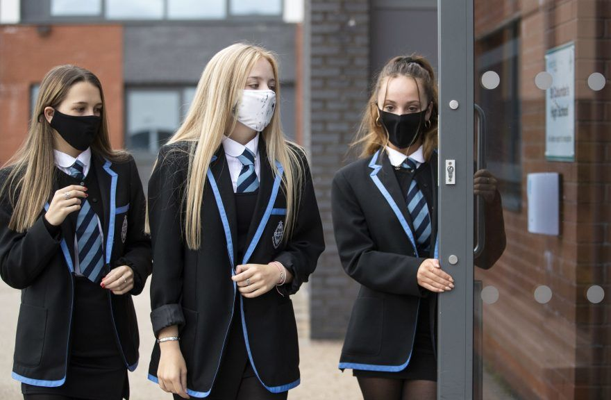 ace masks and physical distancing rules in schools are to be extended.