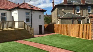 A Glasgow resident has lost a fight to keep her decking.