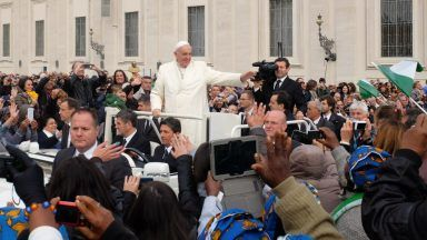 Pope Francis greets attendees at the weekly general audience on October 29, 2014 in Rome.